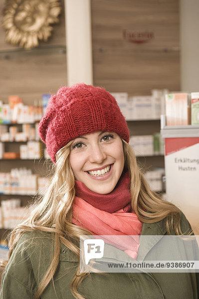 Woman In Pharmacy  Munich  Bavaria  Germany