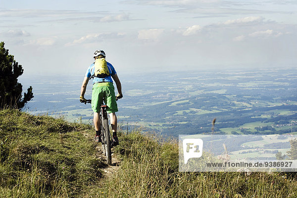 Mountain biker riding on Alpine trail  Samerberg  Germany