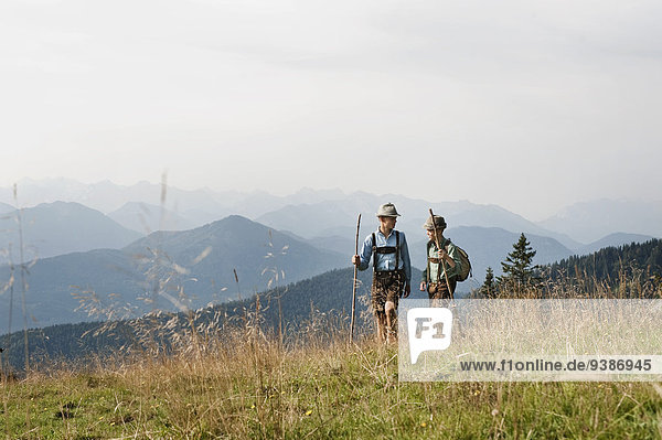 Germany  Bavaria  Two boys hiking in mountains