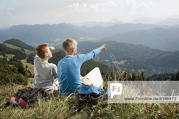 Germany  Bavaria  Two boys in mountains taking a view