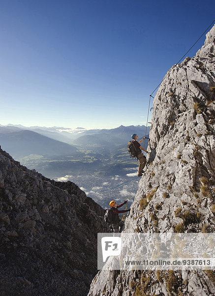 Two alpinists rock climbing  Innsbruck route  Tyrol  Austria