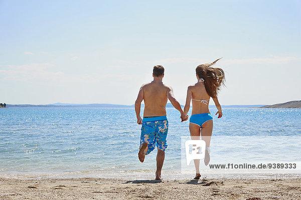 Strand rennen halten jung