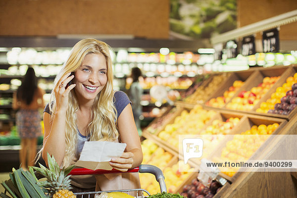 Woman talking on cell phone in grocery store