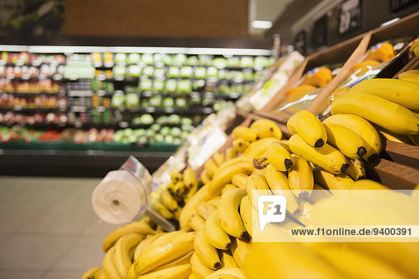 Close up of bananas in produce section of grocery store