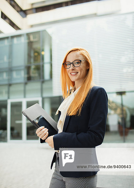 Businesswoman walking outside of office building
