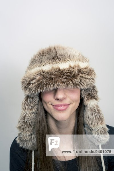 A young woman in a fur hat