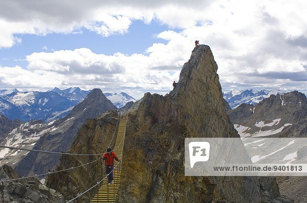 A team climbs a via ferrata