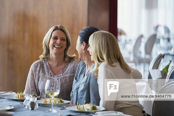 Female friends enjoying meal in restaurant