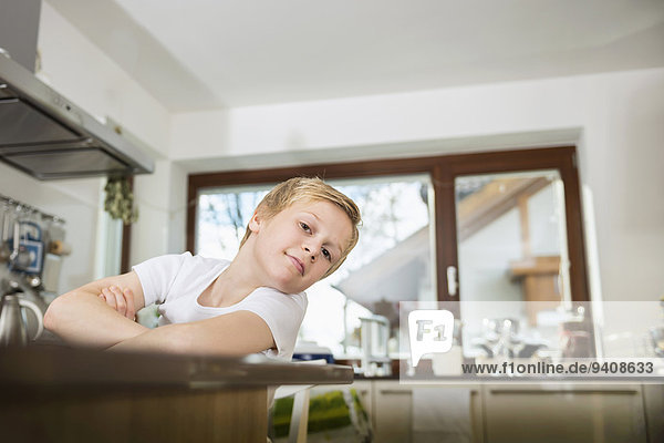 Portrait of smiling boy at home in the kitchen