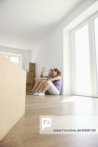 Couple planning packing boxes new apartment