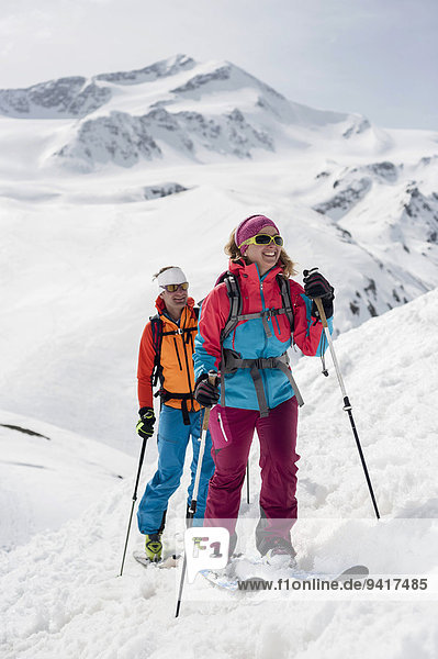 Frau Mann Alpen Skisport querfeldein Cross Country