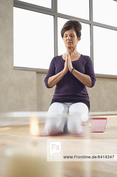 Mature woman Yoga exercise meditation