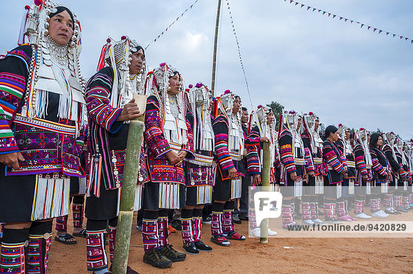 Traditionally dressed women from the Akha people  hill tribe  ethnic minority  dancing  New Year's celebrations  Chiang Rai Province  Northern Thailand  Thailand