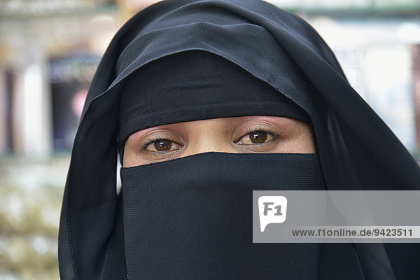 Portrait of a Muslim woman  veiled  Salalah  Dhofar Region  Orient  Oman