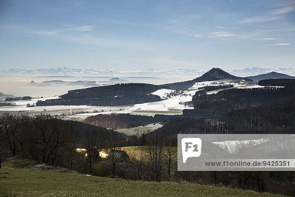 Vollmondnacht mit Sternen vom Hegaublick mit den Hegauvulkanen  Hohenhewen  Hohenstoffel  Hohentwiel  Hohenkrähen  Hegau  Baden-Württemberg  Deutschland