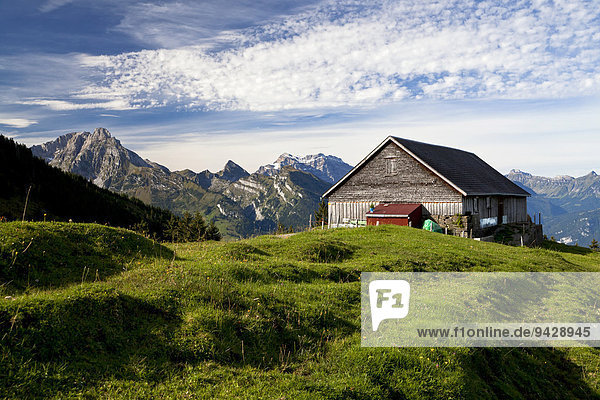 Hiking weather in late summer with a view overlooking the alm  alpine pasture  in Arvenbuehl towards Glaernisch Mountain  Canton of Glarus  Switzerland  Europe
