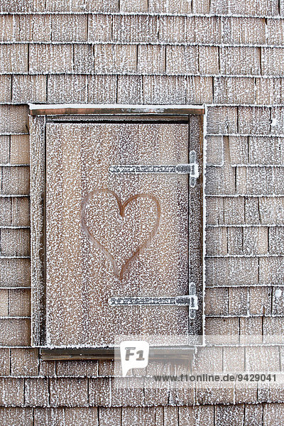 Window with heart and hoarfrost at the Muenchner Haus building on Mt. Zugspitze,  Bavaria,  Germany,  Europe