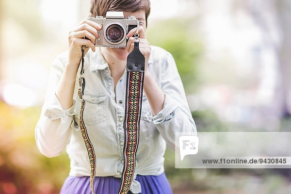 Young woman taking a photograph