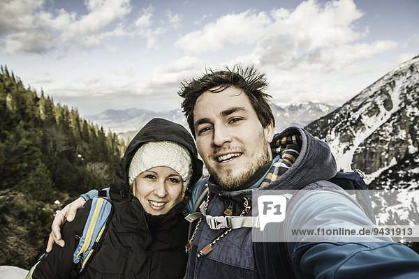 Self portrait of young couple in mountains  Hundsarschjoch  Vils  Bavaria  Germany