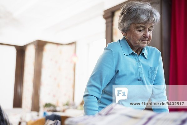 Senior woman wearing blue top