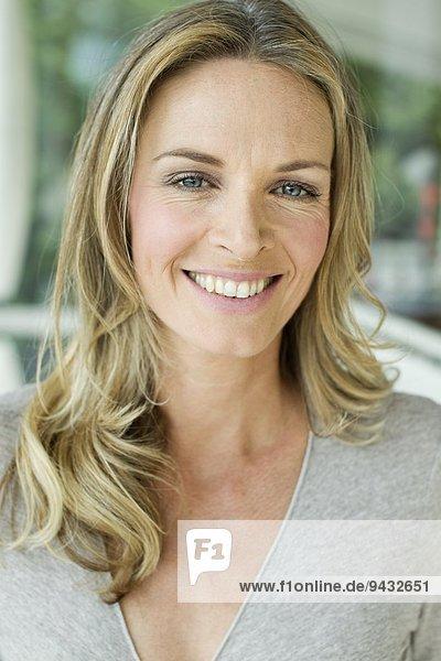 Mature blonde woman  close up portrait