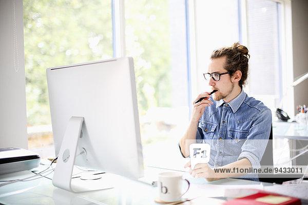 Graphic designer using computer at work
