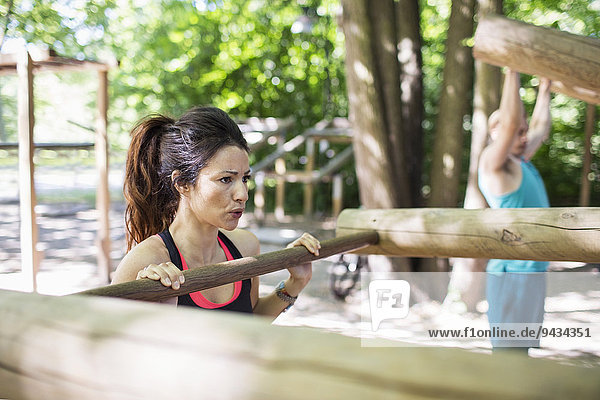 Determined woman exercising at outdoor gym