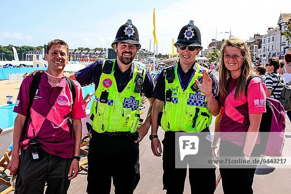 British Policemen and Weymouth Ambassadors on the seafront during the 2012 Olympic games.