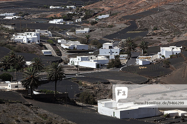 Lava fields  white buildings  Los Valles  Lanzarote  Canary Islands  Spain  Europe