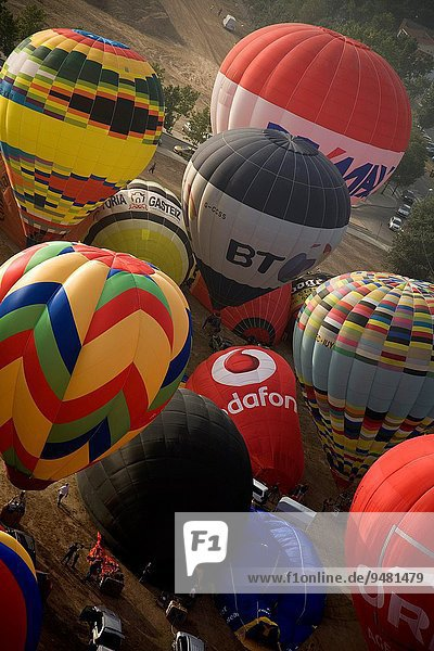 Group of hot air balloons taking off in European hot air balloon festival Igualada  Barcelona  Catalonia  Spain  Europe.