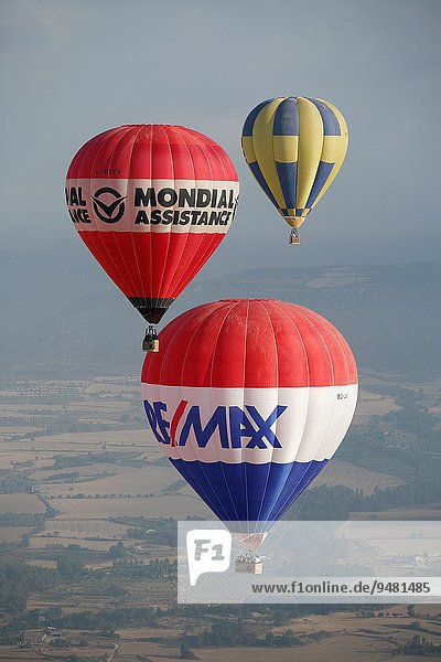 Three flying balloons in European hot air balloon festival Igualada  Barcelona  Catalonia  Spain  Europe.