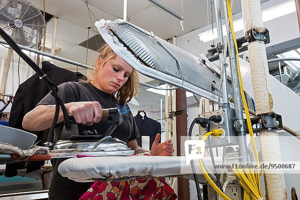 Broomfield  Colorado - A worker at Lionheart Cleaners  a laundry and dry cleaning firm.