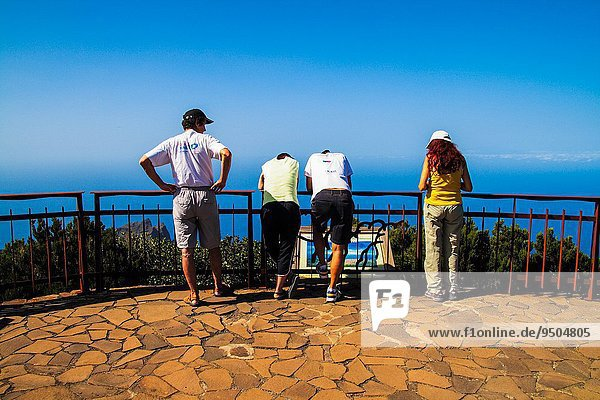 people watching a seascape from a gazebo. Alojera municipality. Gomera island.