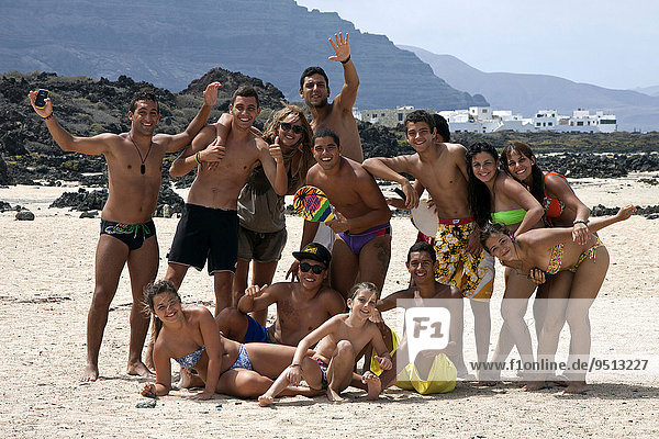 Group of young people on the beach  Bajo de los Sables in Orzola  Lanzarote  Canary Islands  Spain  Europe