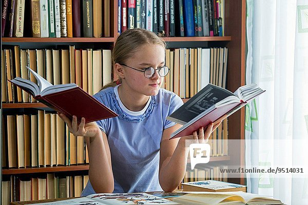 Young girl reading fiction.
