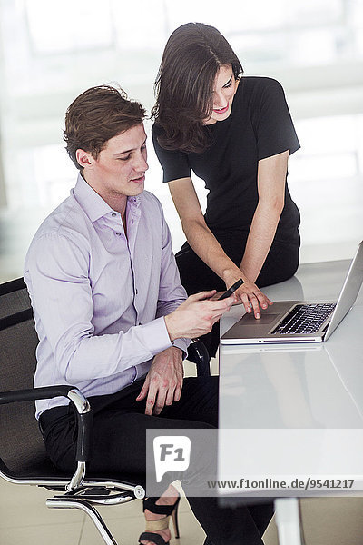 Business people in office working together