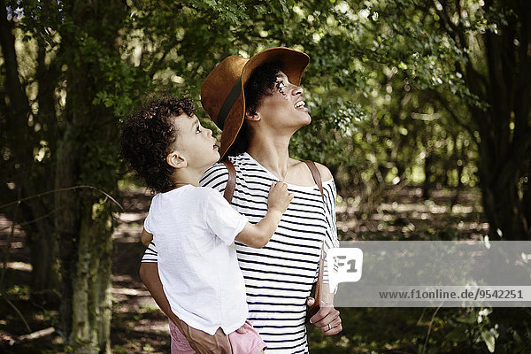 Mother with son in forest