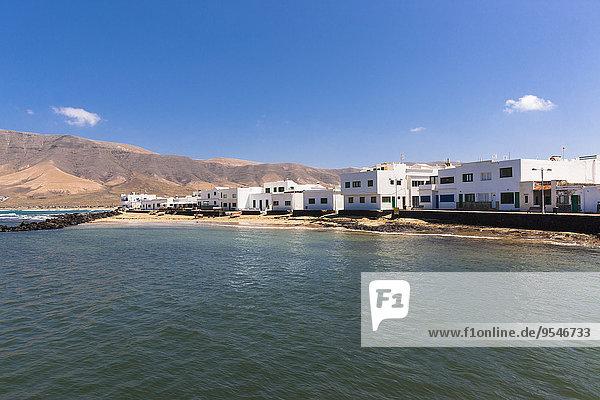 Spanien  Kanarische Inseln  Lanzarote  Los Valles  weiße Häuser in Caleta de la Vila