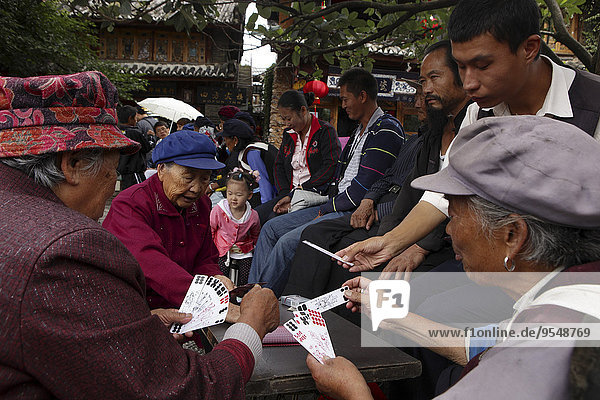 China  Yunnan  Shangri-La County  Lijiang  senior women playing cards in old town