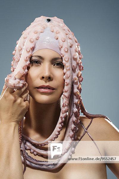 Portrait of woman wearing octopus headdress