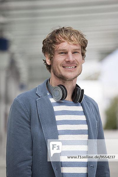 Portrait of man with headphones