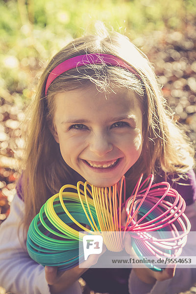 Portrait of smiling little girl with spiral in prismatic colours