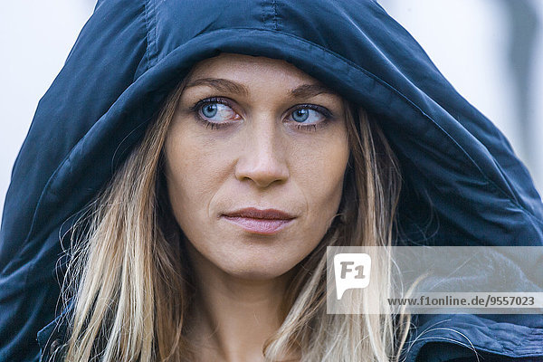 Portrait of blond woman with blue hood