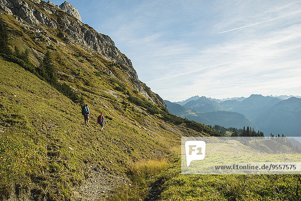 Austria  Tyrol  Tannheimer Tal  young couple hiking
