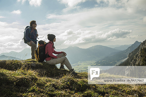 Austria  Tyrol  Tannheimer Tal  young couple resting on hiking tour