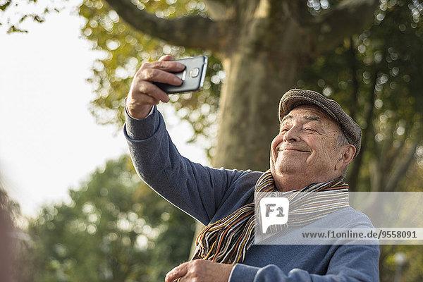 Smiling senior man taking a selfie