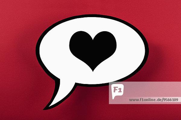 Herz Sprechblase vor rotem Hintergrund