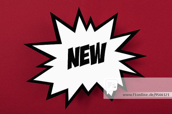 Explodierendes Werbeschild mit NEU vor rotem Hintergrund