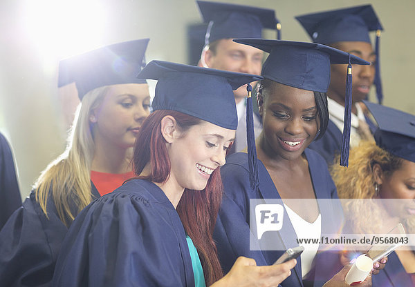 Students texting during graduation ceremony