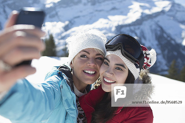 Friends taking selfie in snow